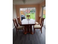 Extending dining room table and 5chairs