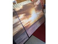 Floor lamp, coffee table and sunset Canvas for sale