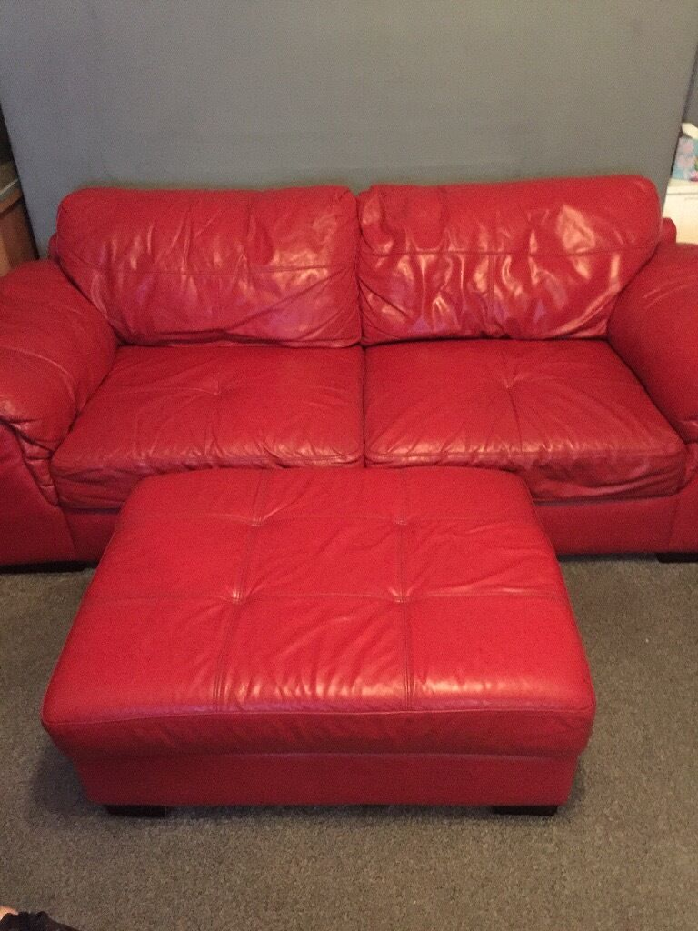 2 red 3 seaters with foot stool