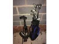 Golf club set. Left hand with bag and trolley