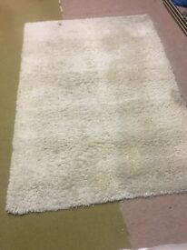 Cream long pile rug.