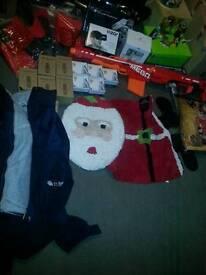 Massive job lot, nurf gun, wheel covers, Christmas stuff, car parts. Gift boxes