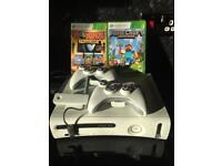 * Xbox 360 60gb with WiFi dongle, 2 wireless controllers & 2 games *