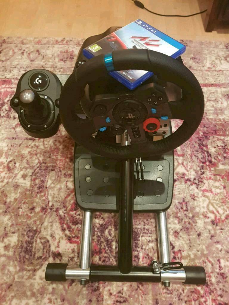 Logitech G29 (PS4) + Shifter + Wheel Stand Pro + Assetto Corsa.