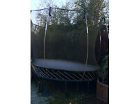 Large Oval trampoline 13ft x 8ft with safety net