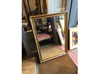 Gold Framed Ornate Mirror , in good condition. Size W 28in L 40in
