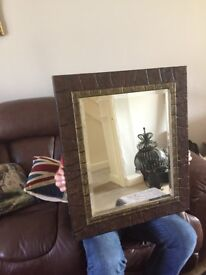 Lovely wall mirror with back sliding compartment