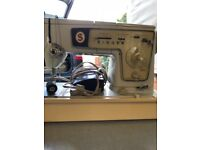 Retro electric Singer sewing machine complete with accessories
