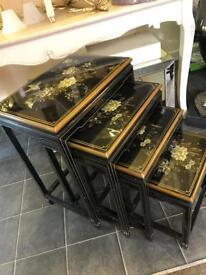 Black lacquer Oriental nest of four tables