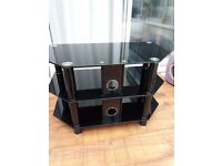 Glass top TV unit.......well used but in good condition. Fits into corner of room.