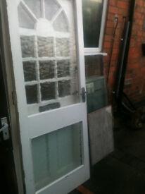 Exterior wooden door with 2 crazed glass panels