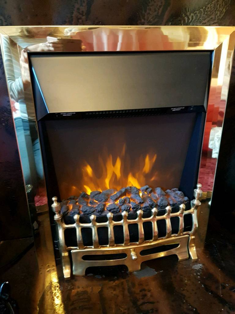As new electric fire with blow heater