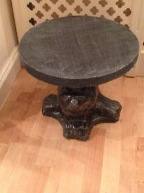 Two matching solid stone lion tables
