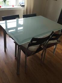 Glass table and four chairs £50 only
