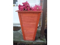 tall wooden planter, hand made in red cedar