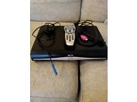 Sky Box (Model DRX890W) + cables and remote control