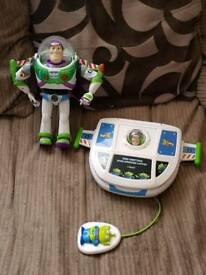 Buzz lightyear, and buzz lightyear spaceship laptop toy