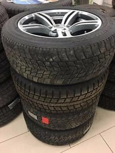 4 Used 235/55R18 Toyo G-O2 winter tires on aftermarket alloy wheels for BMW X5