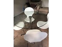 Round Glass dining table and 4 chairs.