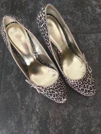 Women's animal print high heels size 7