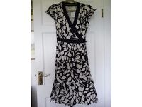 Adini Wrap Dress. Black and White cotton fabric. Small. Never Worn - tag still attached.