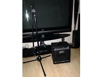 Bought but never used 1 Peavey Amplifier + 1 microphone stand for sale!