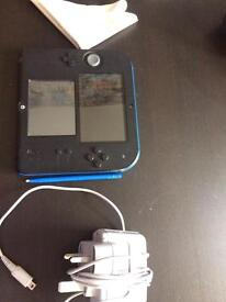 nentendo 2ds preinstalled Mario cart 7 and Pokémon y almost mint condition.