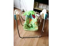 Musical swing cradle