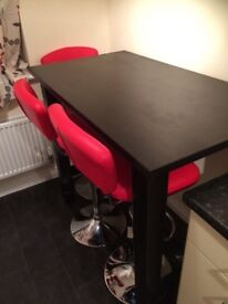 Solid wood table plus four red leather and chrome effect bar stools