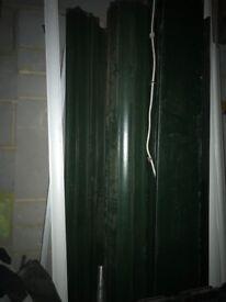 Green electric roller garage door