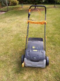 A Titan Lawn Rake and Scarifier
