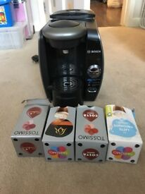 Tassimo coffee machine including some coffee tablets.