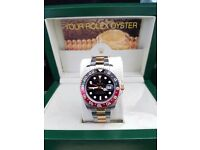 Cola Rolex GMT Master II with black face, Red and black ceramic bezel & a silver & gold oyster strap