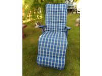 Blue folding reclining chair with cushion