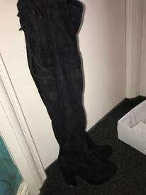 Black high knee boots
