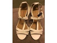 White wedge heel wide fit ladies shoe size 8. Never been worn