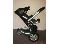 Quinny brand Buzz 3-wheeled pushchair with attachable Dreami carrycot