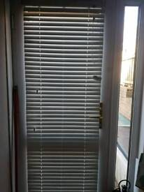 White wooden faux blinds