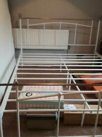 Kingsize metal bedframe in immaculate condition, used for a short time only.
