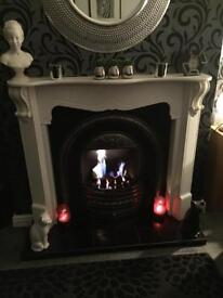 Gas fire and surround.