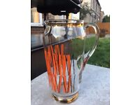 Beautiful vintage glass jug with orange/gold detail