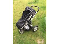 Quincy buzz pushchair with rain over and foot muff