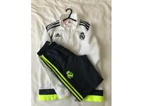 Real Madrid tracksuit 11/12years