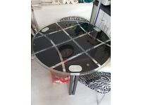 Glass table and chairs good condition.