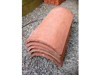 New unused Sandtoft roof half round ridge tiles. Sandfaced mottled red?