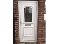 UPC door in white, glazed centre panel, letterbox, spare keys. Complete with frame.