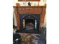 Victorian style fireplace, cast iron facia, Victorian tiles on sides,wood mantlepiece and surround