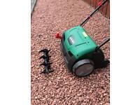 Lawn raker and scarifier