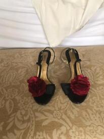 Ladies Black Slingback sandals.