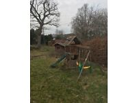 Large wooden double swing and slide set